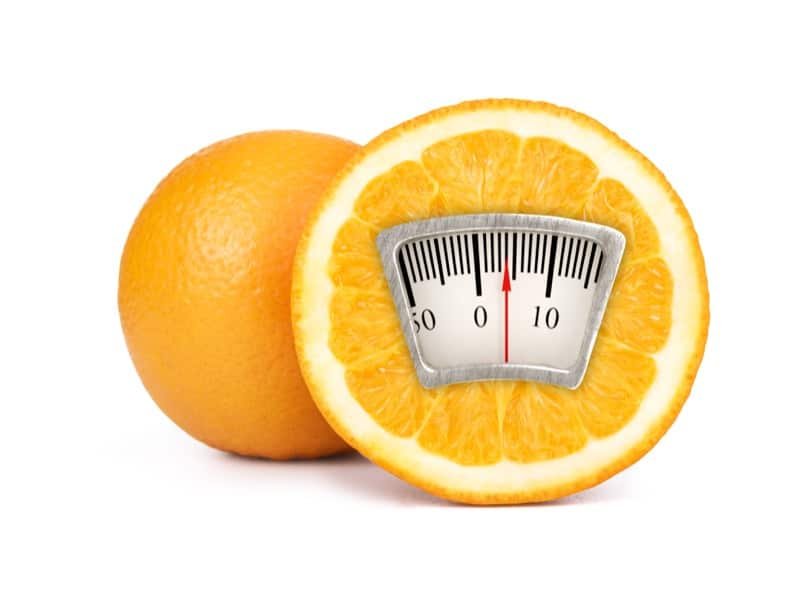weight scale on an orange