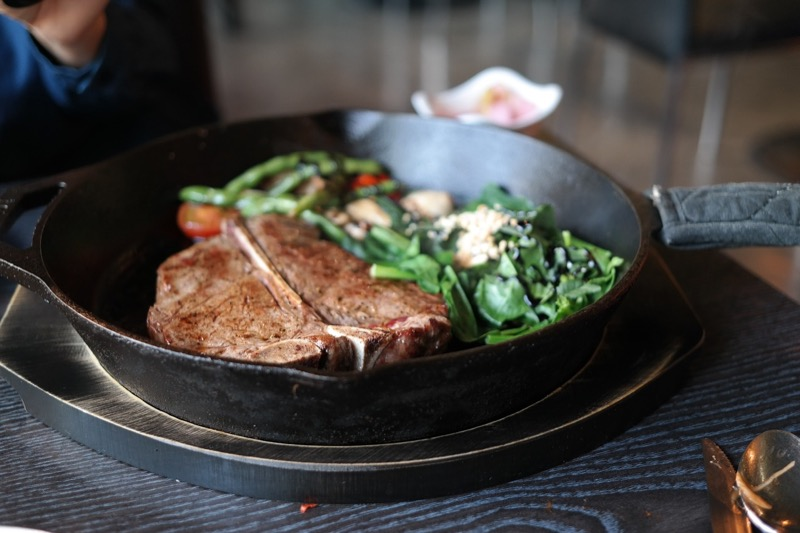 steak with green vegetables